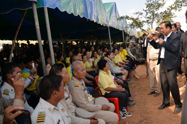 Prime Minister Prayut Chan-o-cha jokes with residents of Chaiyaphum province on Monday. He called for national unity, reminding that the royal coronation will take place