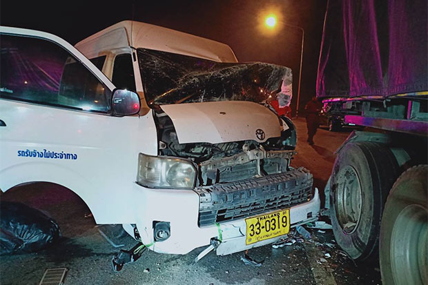 The damaged passenger van was still jammed up against the truck it hit in Bang Pahan district, Ayutthaya, when police arrived on the scene early Tuesday morning. Five of the 11 Myanmar migrant workers on board were taken to hospital with serious injuries. (Photo by Sunthorn Pongpao)