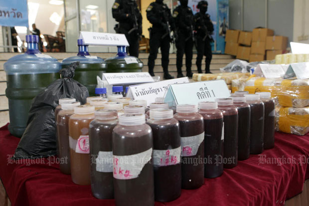 Police display seized cannabis oil allegedly produced at a warehouse in Samut Prakan by a gang that smuggled the drug to Belgium, at the Narcotics Suppression Bureau in Bangkok on Thursday. (Photo by Tawatchai Kemgumnerd)