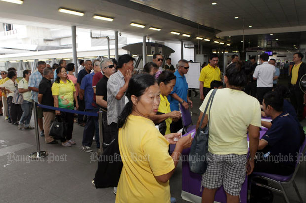 Holders of welfare cards register for electric train fare subsidies in Bangkok in July. The government says it is serious about helping the poor and bridging inequality. (File photo)