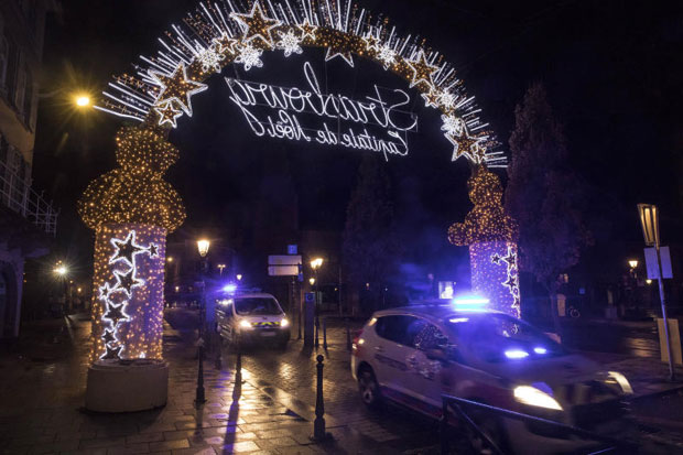 Police vehicles move at the centre of the city of Strasbourg following a shooting in eastern France on Tuesday. (AP photo)