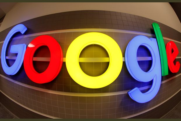 An illuminated Google logo is seen inside an office building in Zurich on Dec 5. (Reuters photo)