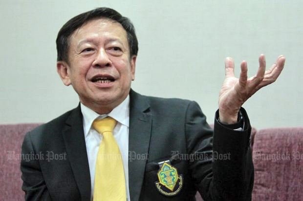 Pol Col Jarungvith Phumma, junta-approved secretary-general of the Election Commission, says there is absolutely no vote-buying or populism in the welfare programme, and the EC will not investigate such allegations. The EC logo is pinned to Pol Col Jarungvith's suit pocket. (File photo by Tawatchai Kemgumnerd)