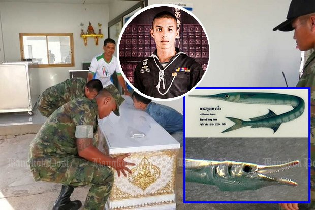 Comrades carry the coffin of Chief Petty Officer 2nd Class Kriengsak