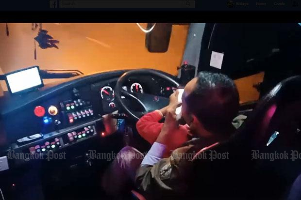 Bus driver chats on phone while son drives