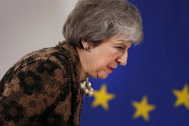 British Prime Minister Theresa May arrives for a media conference at an EU summit in Brussels on Friday. (AP photo)