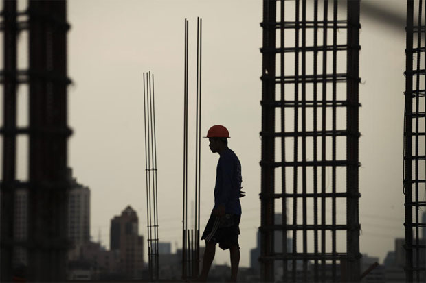 A worker walks at a construction site in the Lat Phrao area of Bangkok. PATIPAT JANTHONG