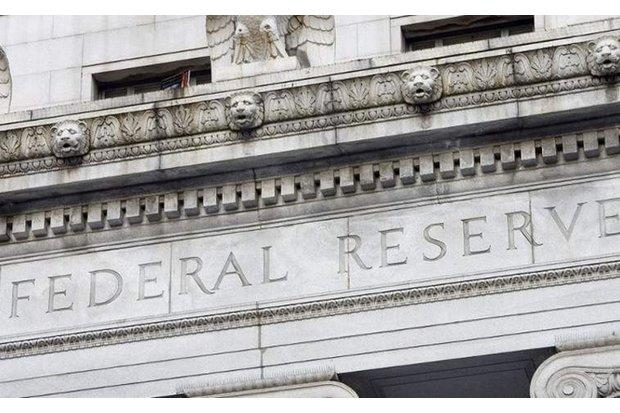 US Fed raises lending rate, signals slower pace