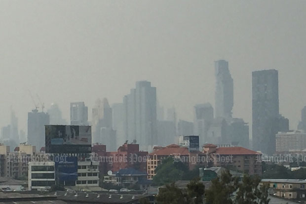 Bangkok's skyscrapers, including its tallest building, stand shrouded in particulate pollution on Friday afternoon. (Photo by Prinya Muangarkas)