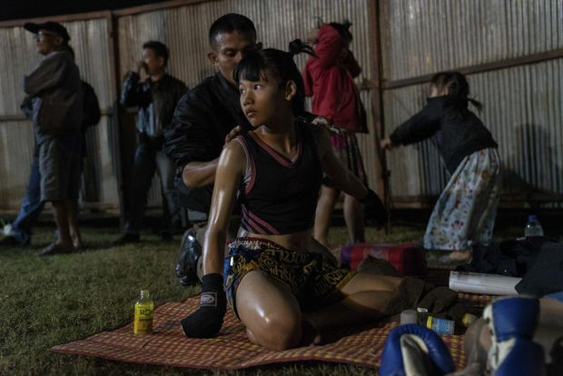 Supattra Inthirat, 12, known as Pancake, with her father before her fight at a small local fighting stage in That Phanom, Thailand, Nov 22, 2018. (NYT photo)