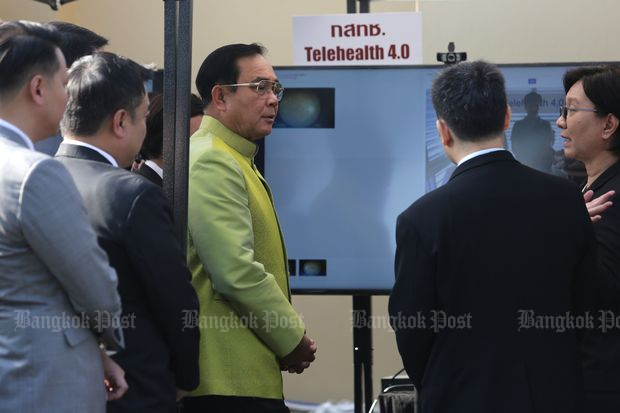 Prime Minister Prayut Chan-o-cha visits an exhibition held by the NBTC at Government House on Tuesday. (Photo by Wichan Charoenkiatpakul)