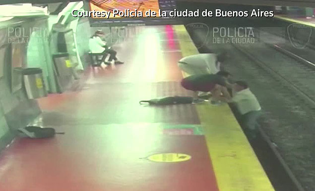A man ambling along the platform of a Buenos Aires subway stop was so engrossed in his cell phone that he didn't notice as he approached the edge and fell off directly onto the tracks. - REUTERS