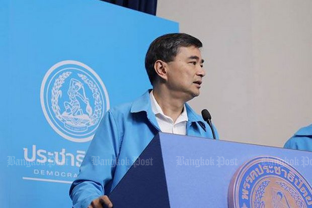 Democrat Party leader Abhisit Vejjajiva told reporters there is no way he could join Pheu Thai in order to select a non-military prime minister. (File photo)