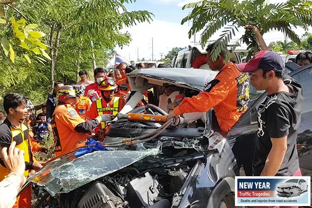 Rescuers extricate the bodies of five people trapped in this sedan after it collided with a pickup truck in Phimai district in Nakhon Ratchasima on Tuesday. (Photo by Prasit Tangprasert)