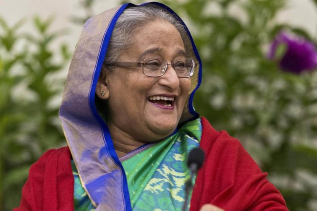 Plenty to laugh about: Bangladesh Prime Minister Sheikh Hasina speaks at a press conference in Dhaka on New Year's Eve. (AFP photo)
