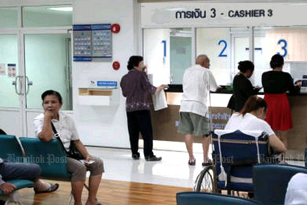 A patient in a wheelchair waits as family go through the bill-paying procedure at Thonburi Hospital. Public outrage about high prices in private hospitals have convinced government to Do Something. (Photo by Tawatchai Kemgumnerd)