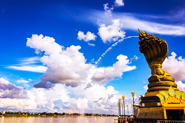 A statue of the Naga serpent with seven heads flows into the Mekong River in Nakhon Phanom province.