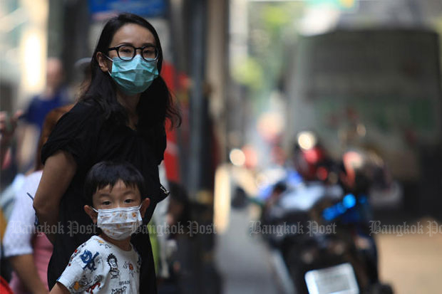 People wear facemasks in Bangkok on Monday as PM2.5 levels increased, posing a bigger threat to people's health. (File photo)