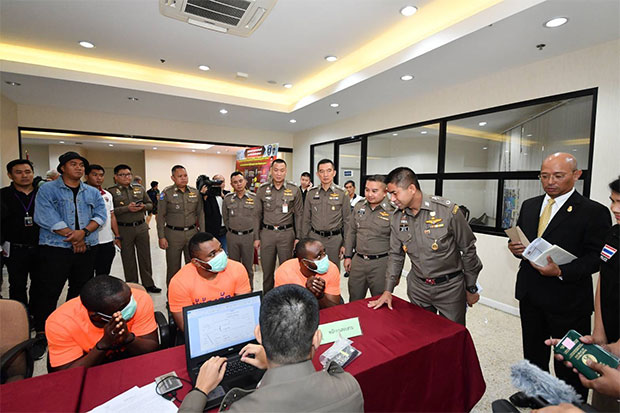 Pol Lt Gen Surachate Hakparn, commissioner of the Immigration Bureau, interrogates some of the five foreign suspects arrested for visa offences. (Supplied photo)