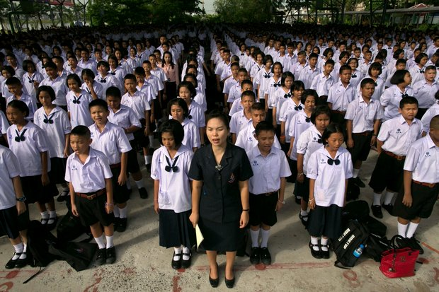 Teacher and students at morning assembly. A developing shortage of teachers could add six months of mandatory service past retirement age for teachers. (NY Times file photo)