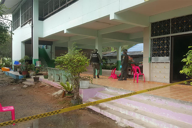 Explosive ordinance disposal officers inspect the murder scene under a building at Bukoh School in Yarang district, Pattani, where four defence volunteers were shot dead while children were studying in classrooms above. (Photo by Abdullah Benjakat)