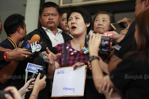 The aunt of the missing girl talks to reporters Thursday about the disappearance of her 14-year-old niece, at the Crime Suppression Division in Bangkok. (Photo by Pornprom Satrabhaya)