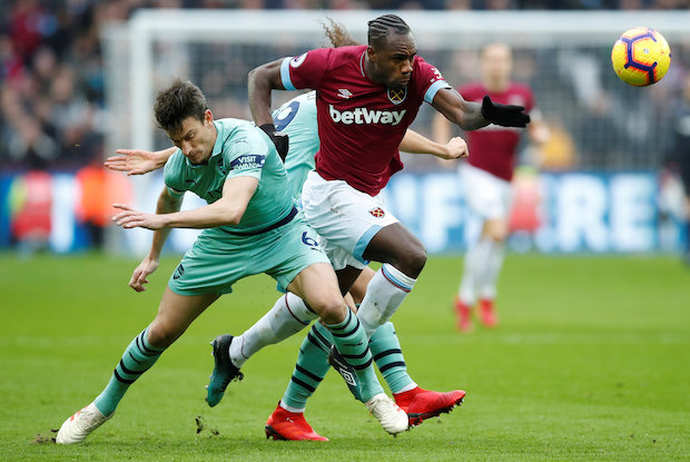 West Ham's Michail Antonio sprints past Arsenal's Laurent Koscielny in pursuit of the ball during the clubs' Premier League match at London Stadium on Saturday. (Reuters Photo)