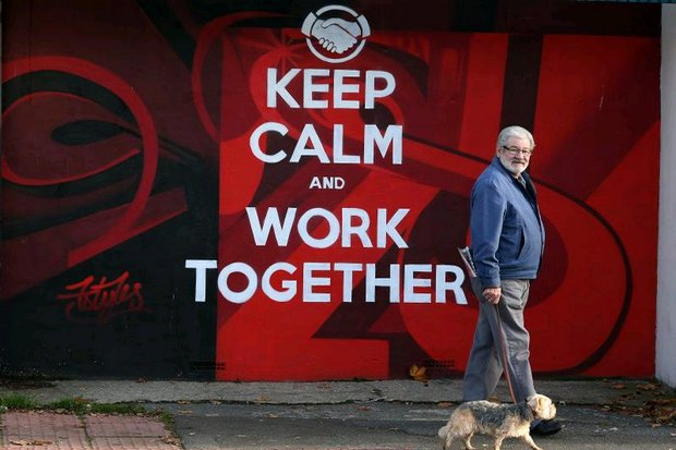 A man walks his dog past graffiti in Sunderland, a city which had a starring role in Britain's decision to leave the EU. (AFP photo)