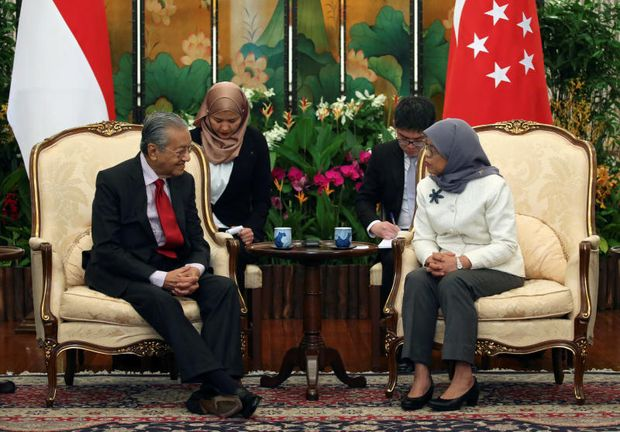 Singapore says Malaysia ties face 'downward spiral'