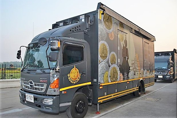 Two of the trucks where people can swap coins for banknotes. The side opens up and has a window where the exchange can be made. (Photo: Treasury Department)
