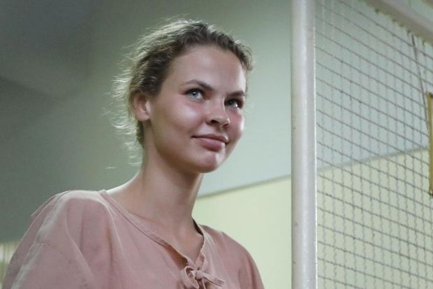 This file photo taken on Aug 20, 2018 shows detained Belarusian model Anastasia Vashukevich better known by her pen name Nastya Rybka, preparing to board a prison van after a court trial in Pattaya, following a police raid on a sex training course. (AFP)
