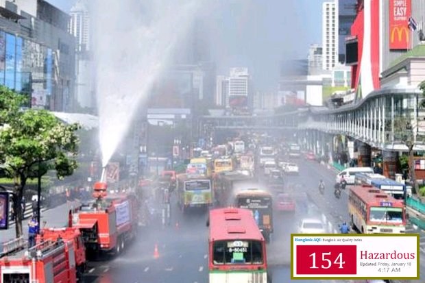 A fire engine shoots water high in the air to cut some of the toxic haze in front of CentralWorld mall. (Photo courtesy Royal Thai Army)
