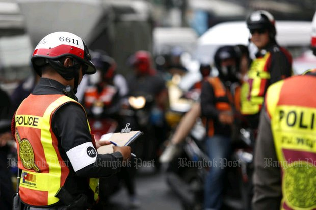 At present, drivers' licences, vehicle registration details and ticketing for violations are legal only on paper. (File photo by Pattarapong Chatpattarasill)