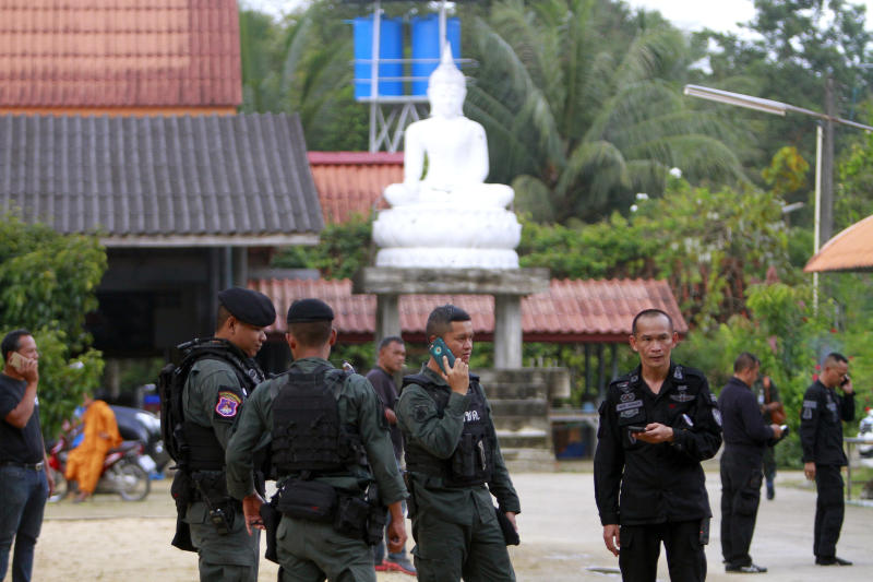 Authorities provide security on Saturday for Wat Rattananuparb in Sungai Padi district of Narathiwat after the deadly attack at the temple on Friday. (Reuters photo)