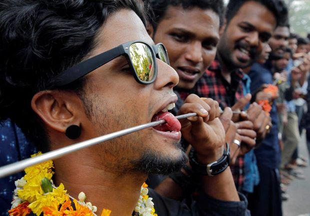 Piercings, incense, drumming: Malaysia marks Thaipusam festival