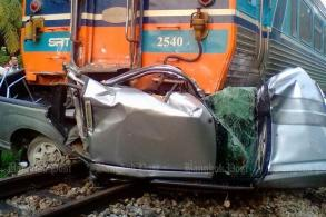 Train crushes pickup, killing woman, son in Surat Thani