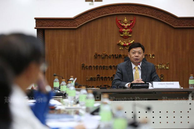 Takorn Tantasith, secretary-general of the National Broadcasting and Telecommunications Commission (NBTC), holds a meeting with mobile phone operators in  January. (File photo)