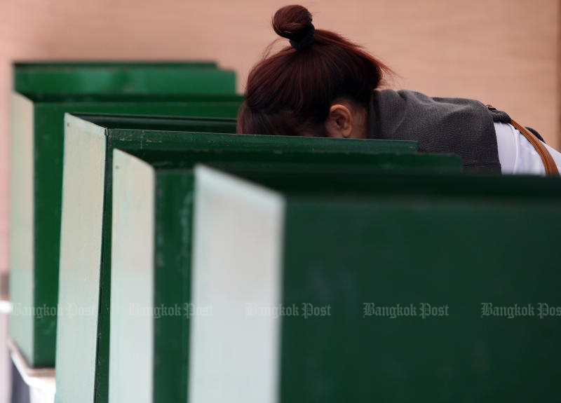 Thais will cast their votes for a new government on March 24, the date set by the Election Commission on Wednesday. (Bangkok Post photo)