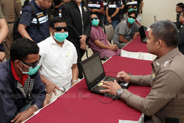 Indian nationals who used Thai women's ID cards to register fake marriages and then apply for spouse visas to stay in the country are questioned at police headquarters in Bangkok on Friday.(Photo by Tawatchai Kemgumnerd)