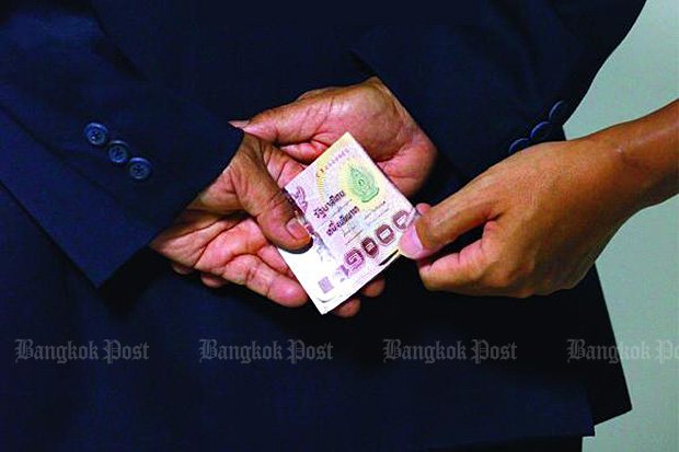 A large majority of people expect vote-buying to be rampant in the March 24 election, according to Nida Poll. (Bangkok Post file photo)
