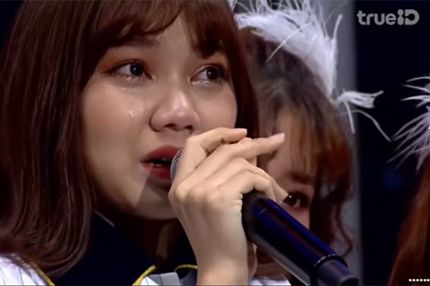 Weeping BNK48 singer apologises for swastika T-shirt