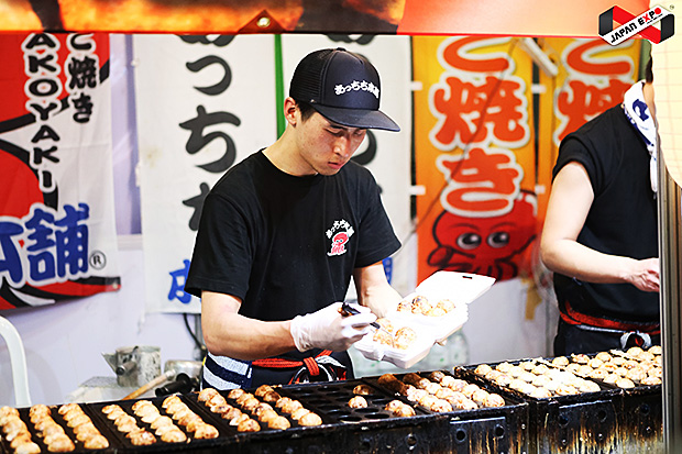 A chef prepares an order at Taste of Japan.