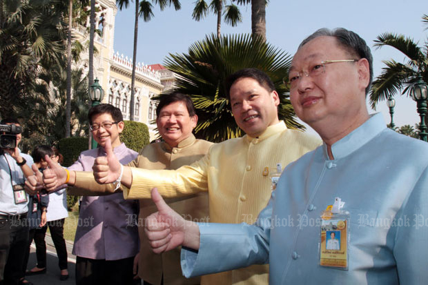 From right, Sontirat Sontijirawong, Uttama Savanayana, Suvit Maesincee and Kobsak Pootrakul pose for photos after submitting their resignations from the cabinet, at Government House on Tuesday morning. (Photo by Tawatchai Kemgumnerd)