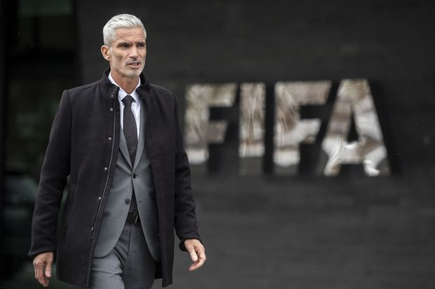 Former Australian national team captain Craig Foster walks after a briefing on the illegal detention of refugee football player Hakeem al-Araibi at the Fifa headquarters in Zurich on Monday. (Ennio Leanza/Keystone via AP)