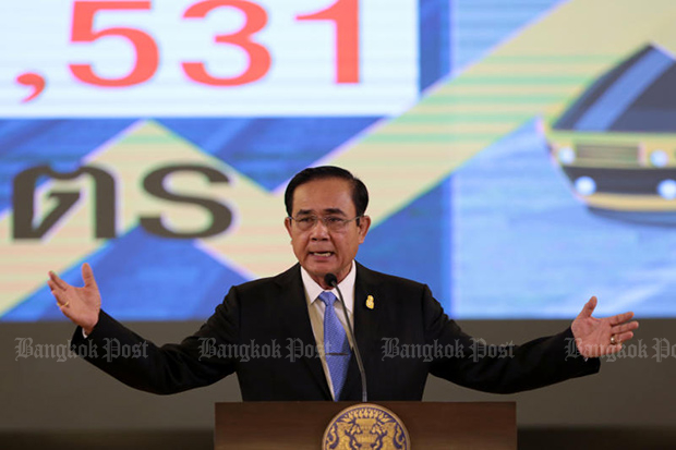 Prime Minister Prayut Chan-o-cha forcefully asserts his decision to stay in power throughout the election process, during a news conference at Government House on Friday. (Photo by Chanat Katanyu)