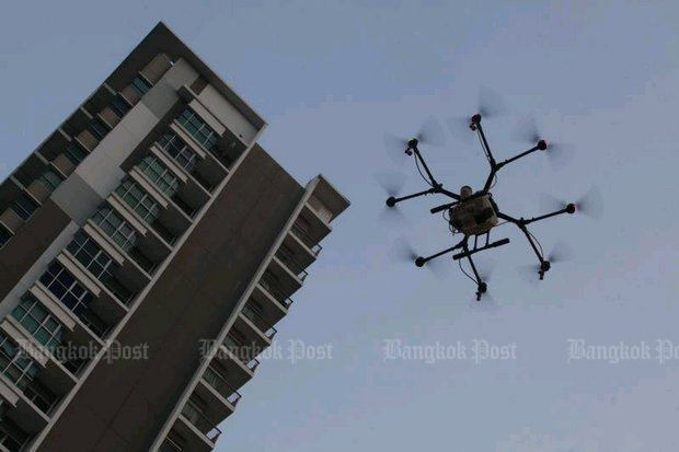 A drone carries 5 litres of water to spray over dust-critical areas of Bangkok. (Photo by Pornprom Satrabhaya)