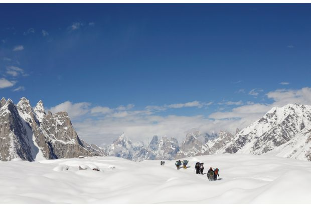 Trekkers and porters hike down the Baltoro glacier in the Karakoram mountain range in Pakistan on Sept 7, 2014. (Reuters photo)