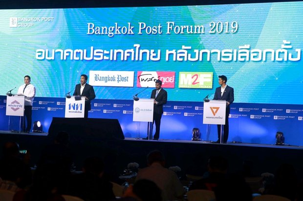 Key political party leaders addressed the Forum. From left, Uttama Savanayana of Palang Pracharath Party, Chadchart Sittipunt of Pheu Thai, Democrat Party leader Abhisit Vejjajiva and Thanathorn Juangroongruangkit, founder and leader of Future Forward Party. (Photo by Weerawong Wongpreedee)