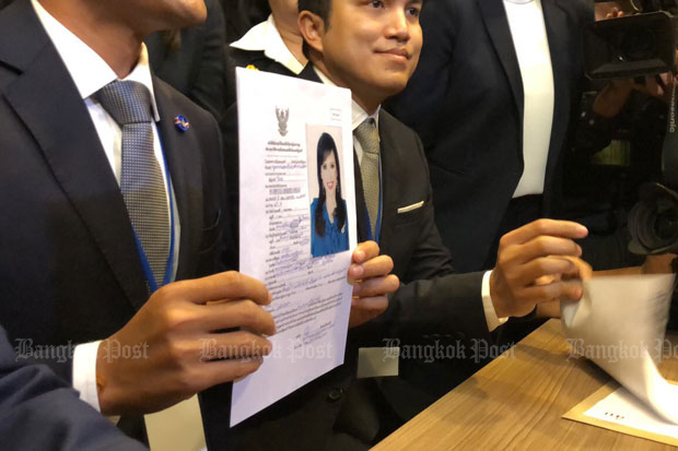 Executives of the Thai Raksa Chart Party shows its document nominating Princess Ubolratana as its prime minister candidate at the Office of the Election Commission in Bangkok on Friday. (Photo by Aekarach Sattaburuth)