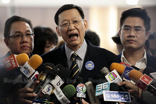Paiboon Nititawan, centre, leader of the People Reform Party, speaks to the media after submitting a letter to the Election Commission asking if Thai Raksa Chart Party violated the law in nominating Princess Ubolratana as its prime ministerial candidate. (Photo by Patipat Janthong)